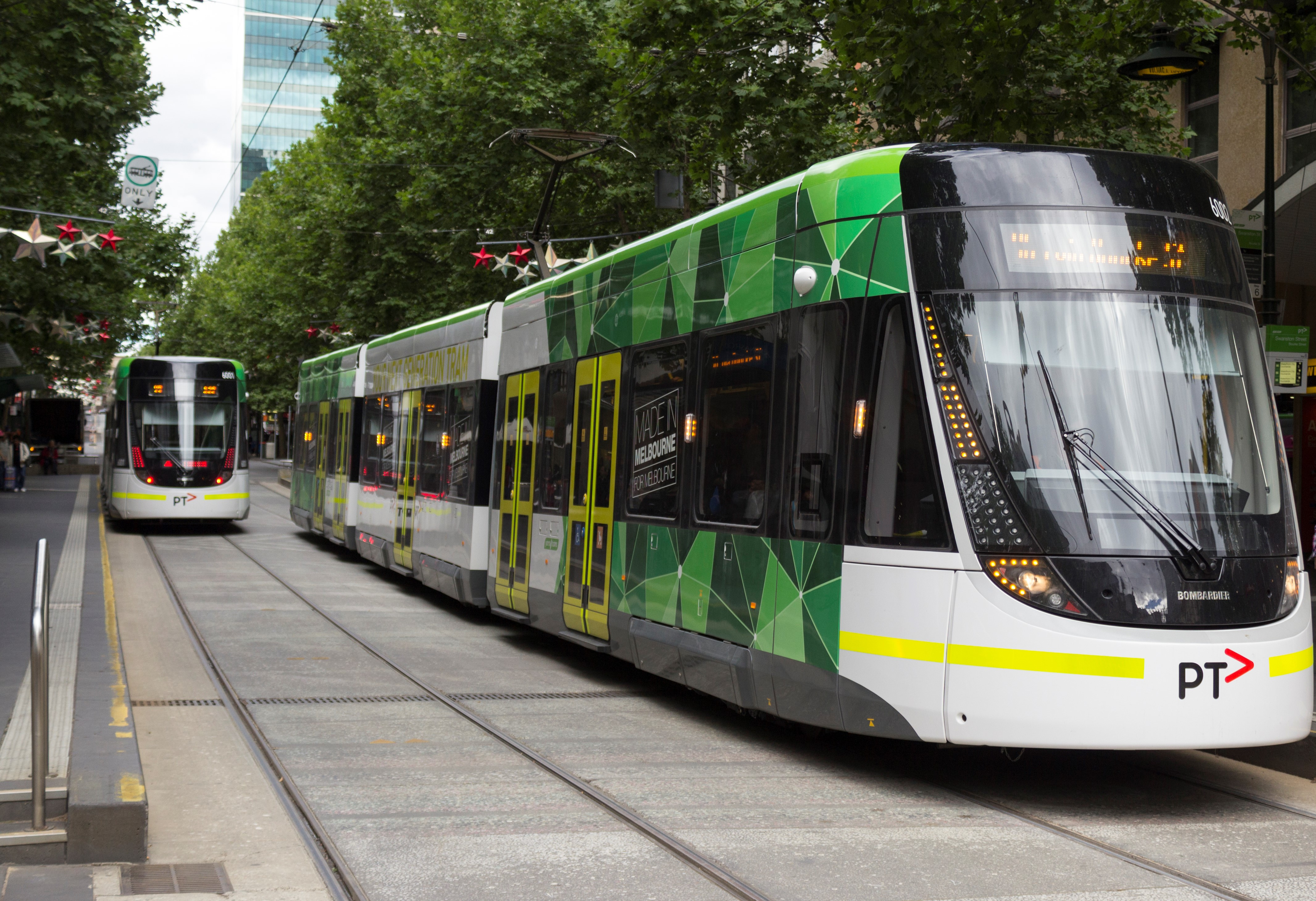 E_6001_and_E_6002_(Melbourne_trams)_in_Bourke_St_on_route_96,_2013